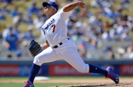 WATCH: Julio Urias Tumbles While Fielding Ground Ball